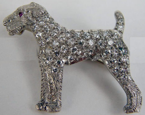 Click to see full size: Diamond and platinum diamond brooch of a standing Airedale Terrier, by the famous Philadelphia jeweller J.E. Caldwell & Co, marked