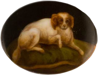 Click to see full size: Berlin school porcelain oval miniature of a Blenheim Spaniel- Berlin school porcelain oval miniature of a Blenheim Spaniel recumbent upon a gold braided green velvet cushion.<br />