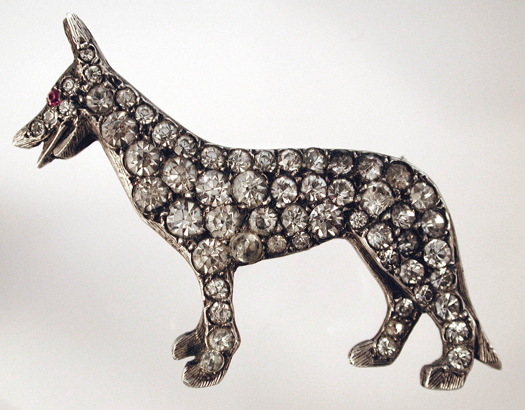 Click to see full size: -   German Shepherd, Brooch, in silver set rose cut paste, with paste inlaid eyes. Marked ?Made in England Sterling?, circa 1915.
