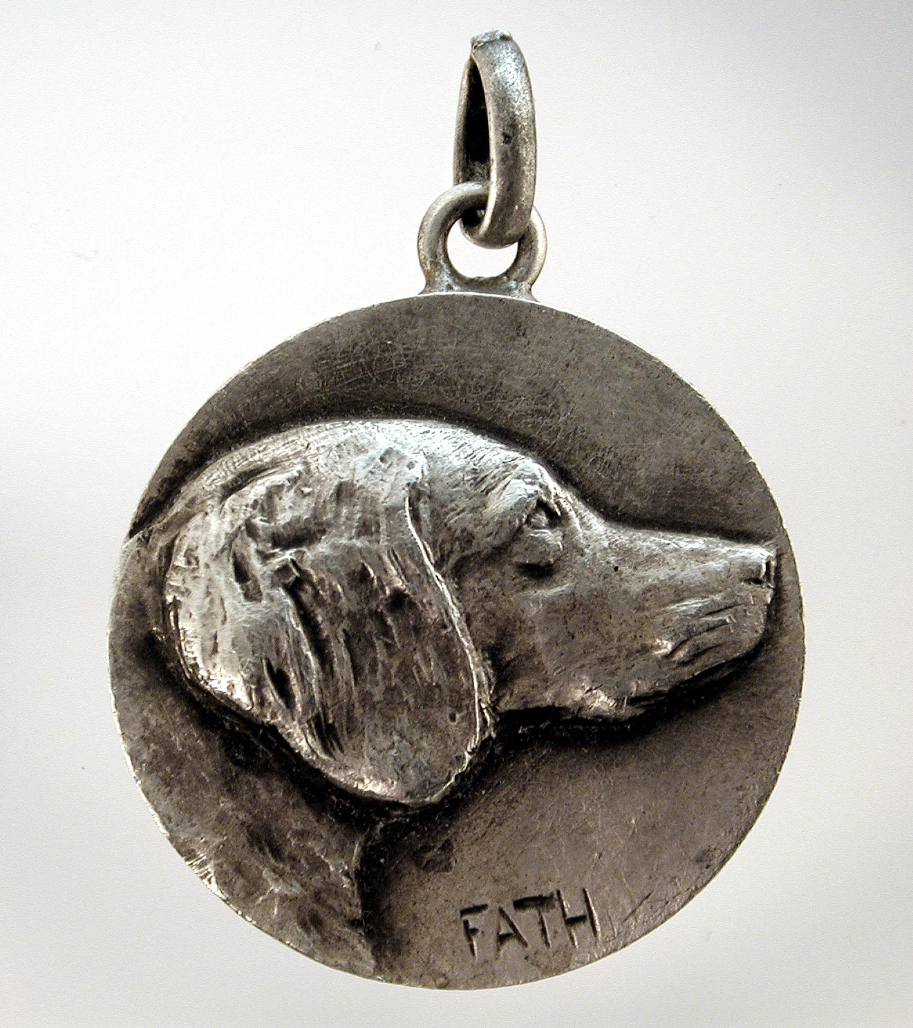 Click to see full size:  Flat-Coat Retriever-  Richard Fath (1900 ? 1952), silvered pendant, Flat-Coat Retriever French, circa 1940, signed ?Fath?.