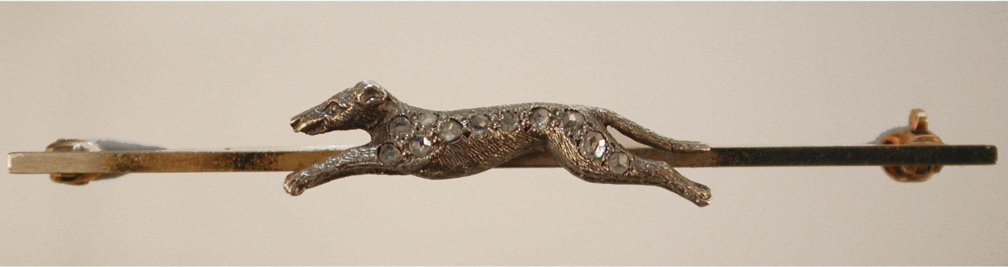 Click to see full size: Coursing Greyhound-   Coursing Greyhound, old cut silver set diamond dog bar brooch with engraved detailing. 9 carat gold bar. English, circa 1890. (3) French (1)