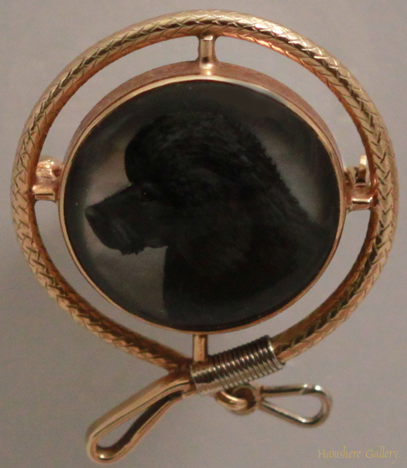 Click to see full size: Reverse intaglio crystal brooch of a Poodle