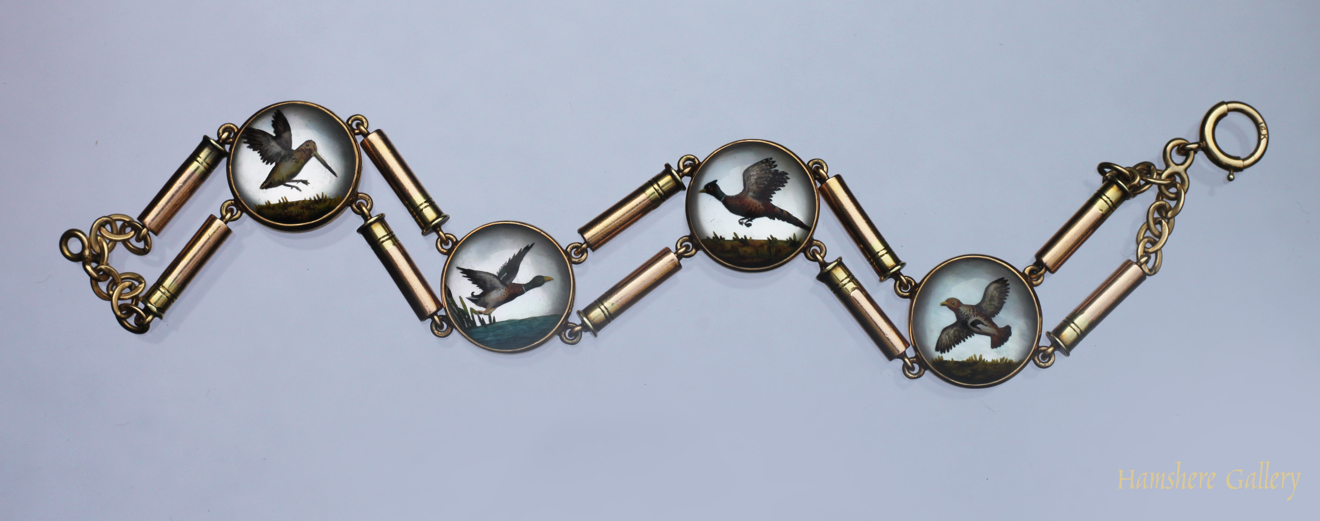 Click to see full size: Reverse intaglio crystal game bird gold bracelet