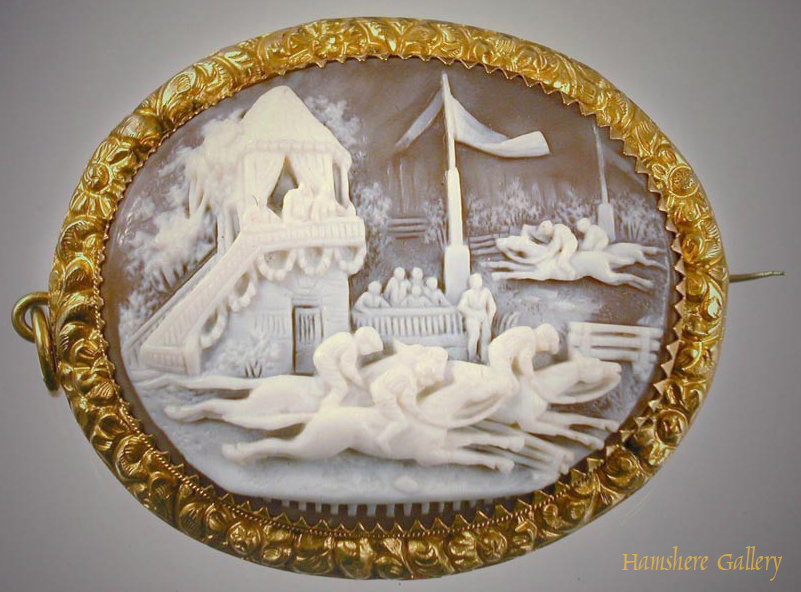 Click to see full size: Gold set cameo brooch of a French horse racing scene- Gold set cameo brooch of a French horse racing scene