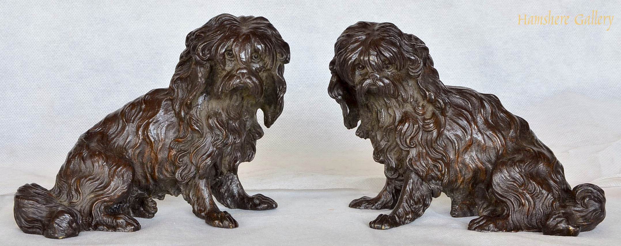 Click to see full size: A 19th century pair of seated Maltese bronze