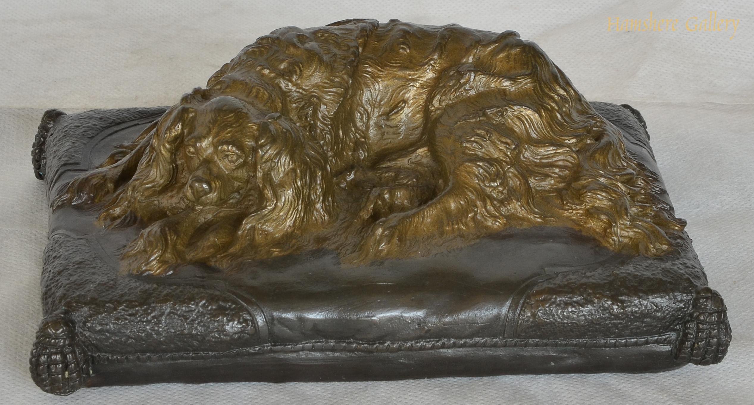 Click to see full size: A 19th century Recumbent Maltese bronze
