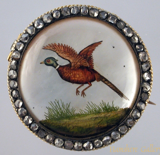 Click to see full size: Reverse intaglio crystal brooch of a pheasant