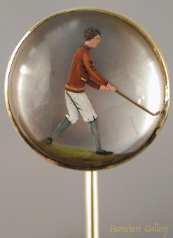 Click to see full size: Reverse intaglio crystal stick pin of a golfer