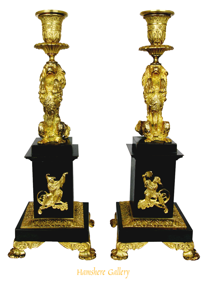 Click to see full size: A Regency Pair Of King Charles Cavalier Bronze And Ormoly Candlesticks- A Regency Pair Of King Charles Cavalier Bronze And Ormoly Candlesticks