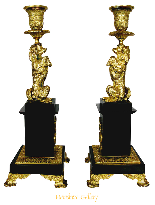 Click for larger image: A Regency Pair Of King Charles Cavalier Bronze And Ormoly Candlesticks - A Regency Pair Of King Charles Cavalier Bronze And Ormoly Candlesticks