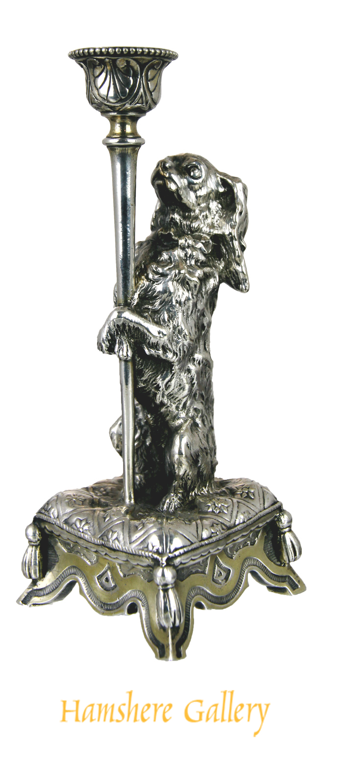 Click for larger image: A rare mid 19th century silver plated King Charles Cavalier Spaniel taperstick / candlestick by Elkington & Co, after John Bell (English, 1811-1895) - A rare mid 19th century silver plated King Charles Cavalier Spaniel taperstick / candlestick by Elkington & Co, after John Bell (English, 1811-1895)