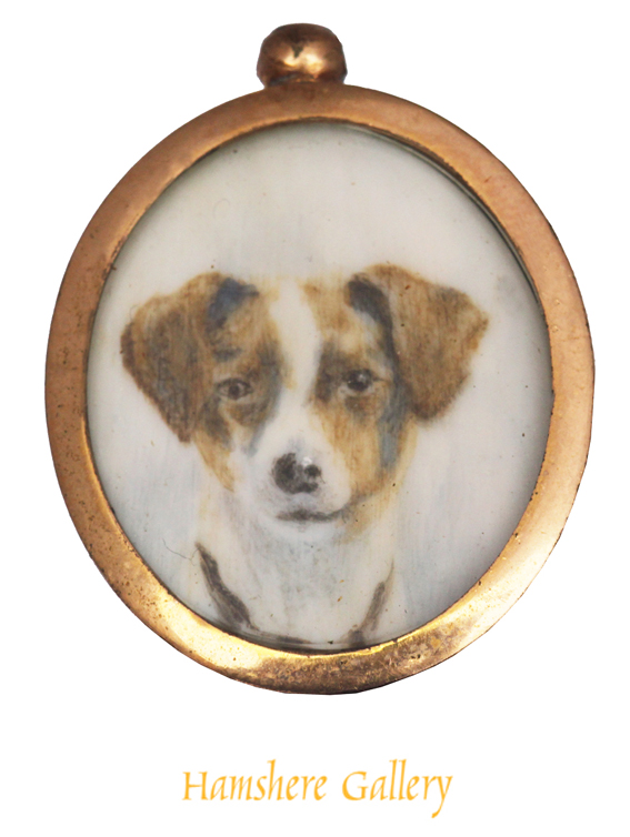 Click to see full size: An oval Victorian miniature on ivory of a Jack Russell in 9 carat gold pendant setting