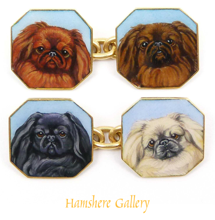 Click to see full size: A set of double sided 18ct gold and enamel octagonal chain link cufflinks of miniature in enamel of Pekingese heads.