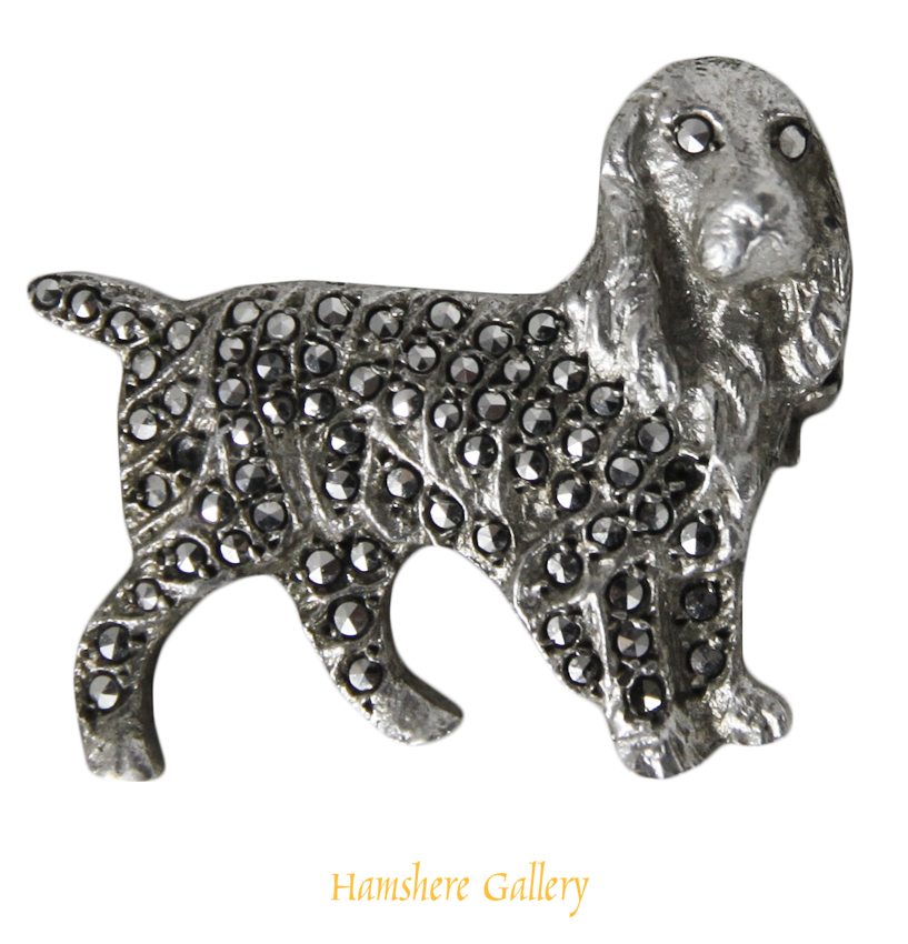 Click to see full size: Early 20th century silver set marcasite brooch of a Cairn Terrier