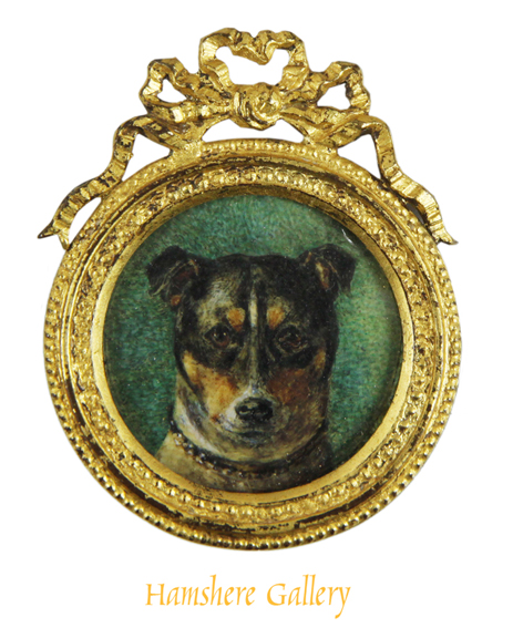 Click to see full size: An circular Victorian miniature a Jack Russell in gilt frame.