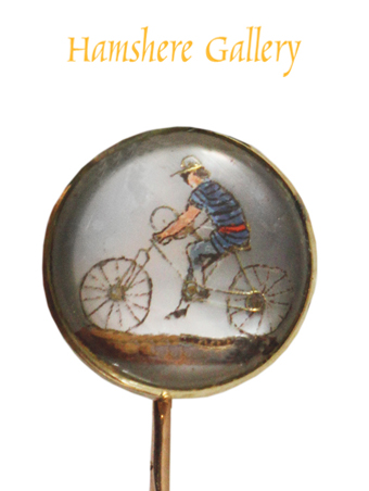 Click to see full size: A reverse intaglio crystal stick pin of  a cyclist