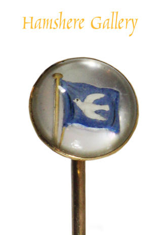 Click to see full size: A reverse intaglio crystal stick pin of a yachting ensign of a dove