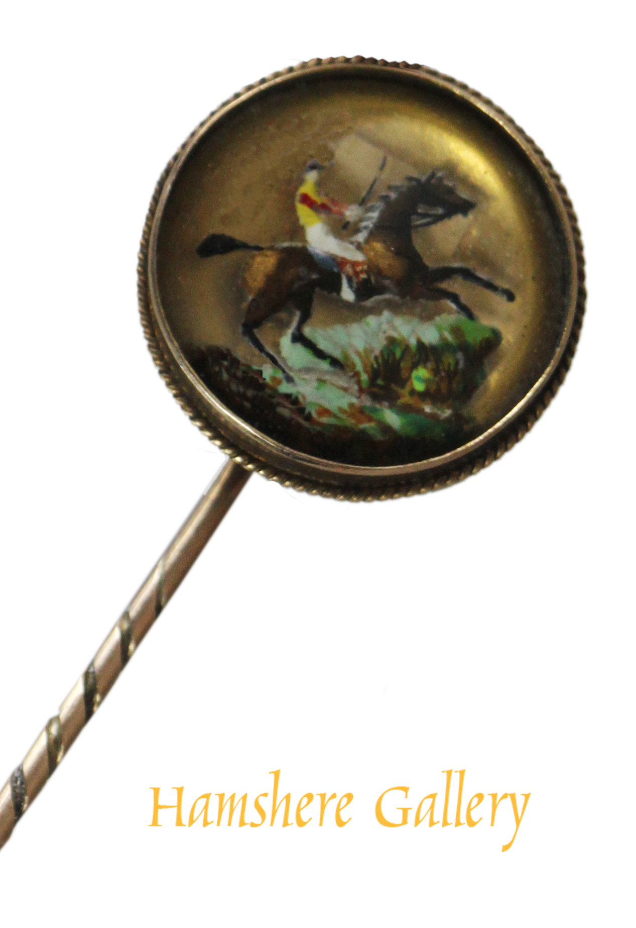 Click to see full size: An equestrian reverse intaglio crystal gold stick pin of a steeplechaser before a water fence