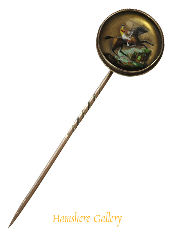 Click to see full size: An equestrian reverse intaglio crystal gold stick pin of a steeplechaser before a water fence- An equestrian reverse intaglio crystal gold stick pin of a steeplechaser before a water fence