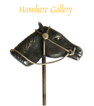 Click to see full size: A patinated bronze and gold horse head stick pin