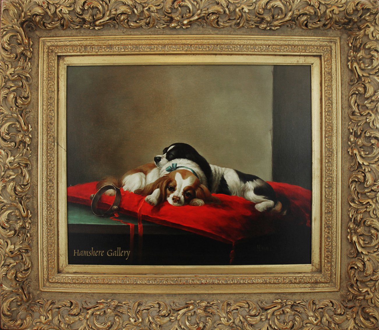 Click to see full size: Oil on board of two King Charles Cavalier Spaniels resting on a red cushion by H Hagel. �Signed �H Hagel�- Oil on board of two King Charles Cavalier Spaniels resting on a red cushion by H Hagel. �Signed �H Hagel�