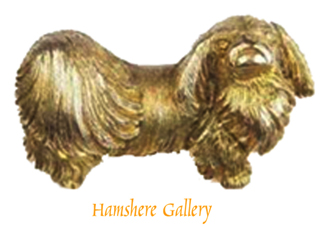 Click to see full size:  An early 20th century 9 carat gold Pekingese brooch