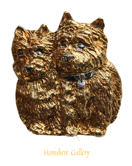 Click to see full size: A 1960�s 18 carat gold Cairn Terrier brooch retailed by �Garrard The Crown Jewellers�