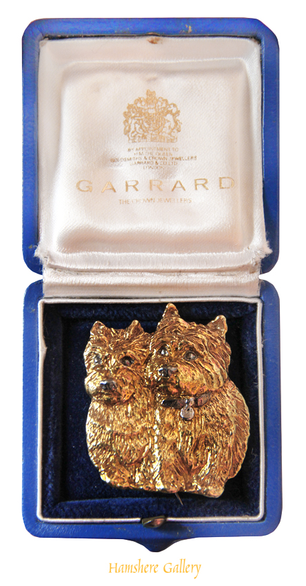 Click for larger image: A 1960�s 18 carat gold Cairn Terrier brooch retailed by �Garrard The Crown Jewellers� - A 1960�s 18 carat gold Cairn Terrier brooch retailed by �Garrard The Crown Jewellers�