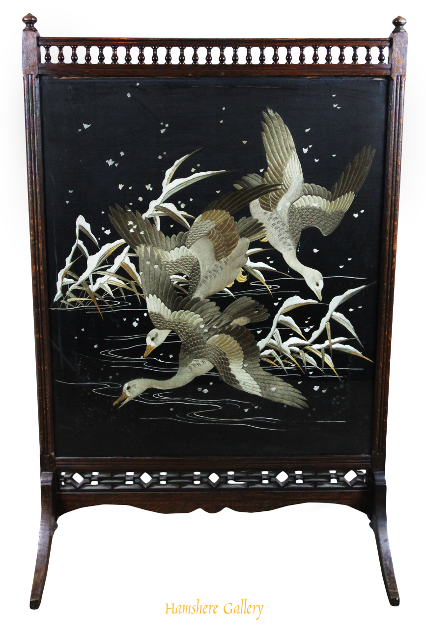 Click to see full size: A Japanese Meiji period silk embroidery / textile of cranes flying in snow framed within an Aesthetic School fire screen