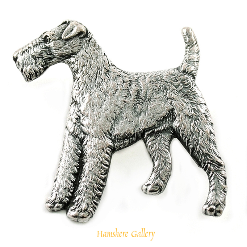 Click to see full size: Silver Kenart Brooch of a standing Wire-haired Fox Terrier.