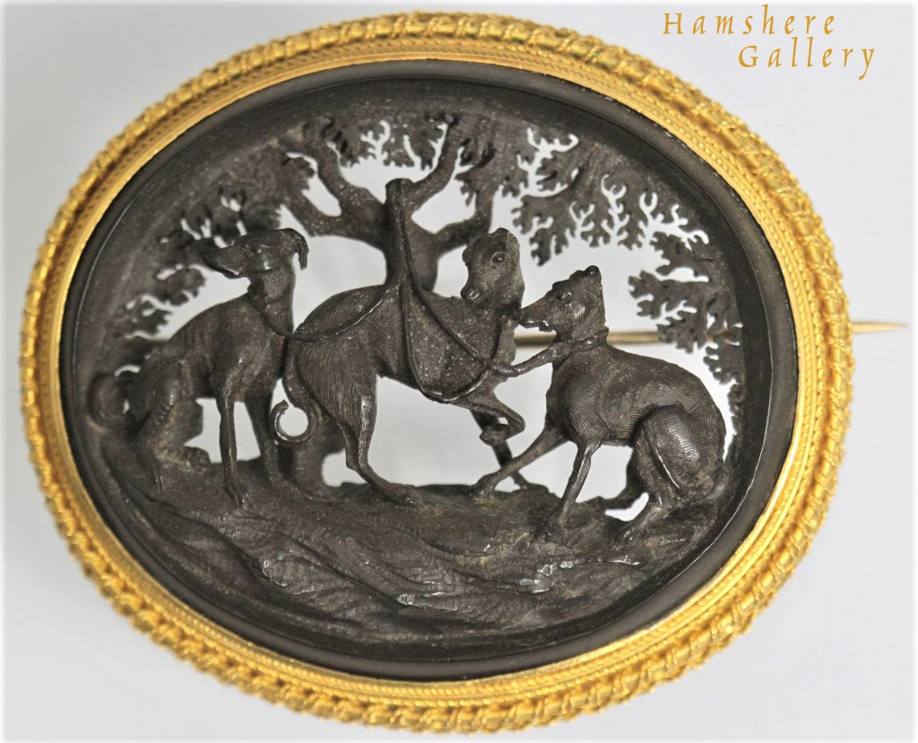 Click to see full size: An extraordinary fine bog oak and gold Whippet / Italian Greyhound oval brooch