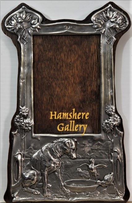 Click to see full size: A 19th century Victorian easel back silver photograph frame depicting a seated Jack Russell / Smooth-haired Fox Terrier