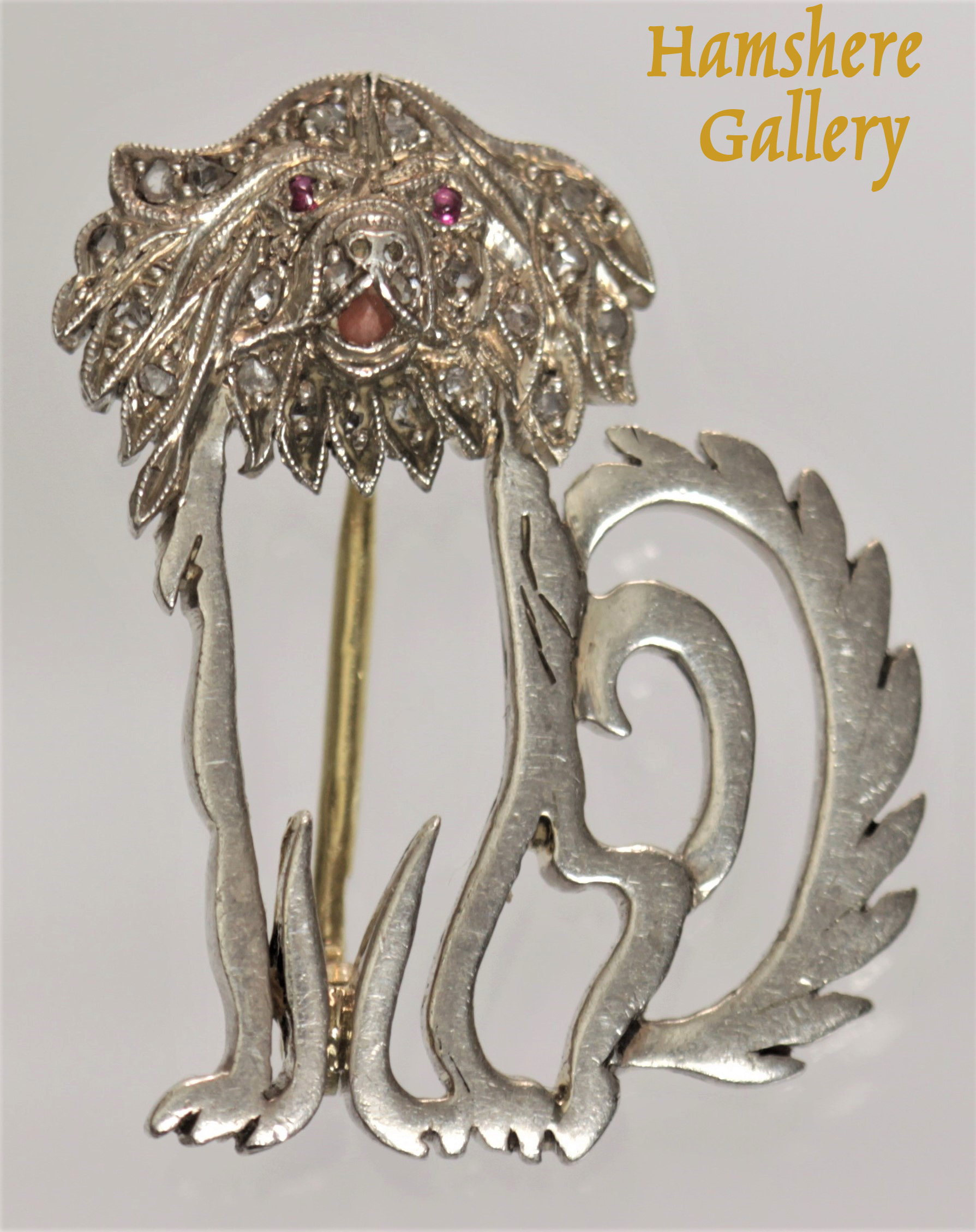 Click to see full size:    Late 19th century Belle Époque diamond, ruby enamel, platinum set Japanese Chin brooch