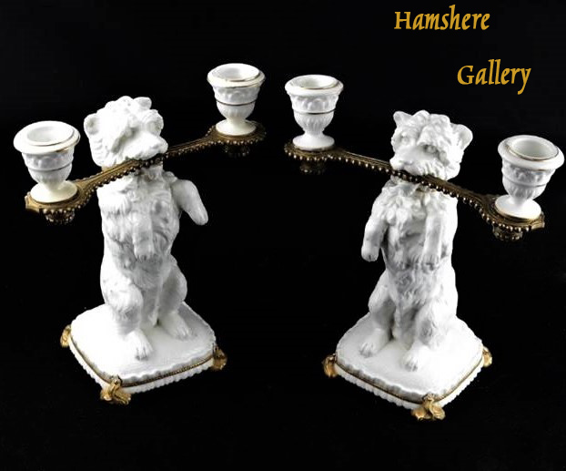 Click to see full size: Bronze and porcelain West Highland Terrier candlesticks by William Brownfield (English, 1812-1873)