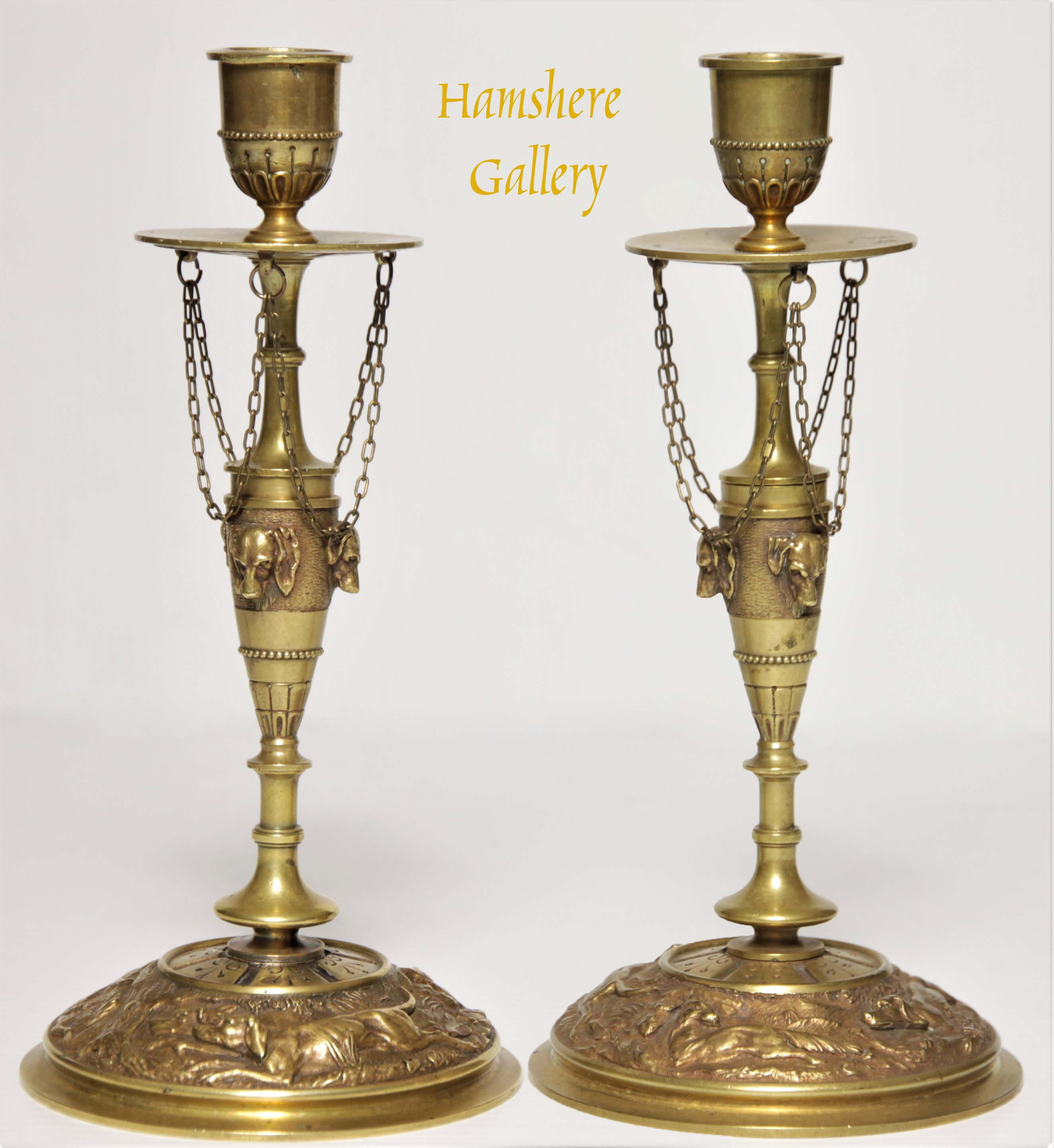 Click to see full size: A pair of Setter bronze candlesticks by Jules Moigniez (French, 1835-1894)