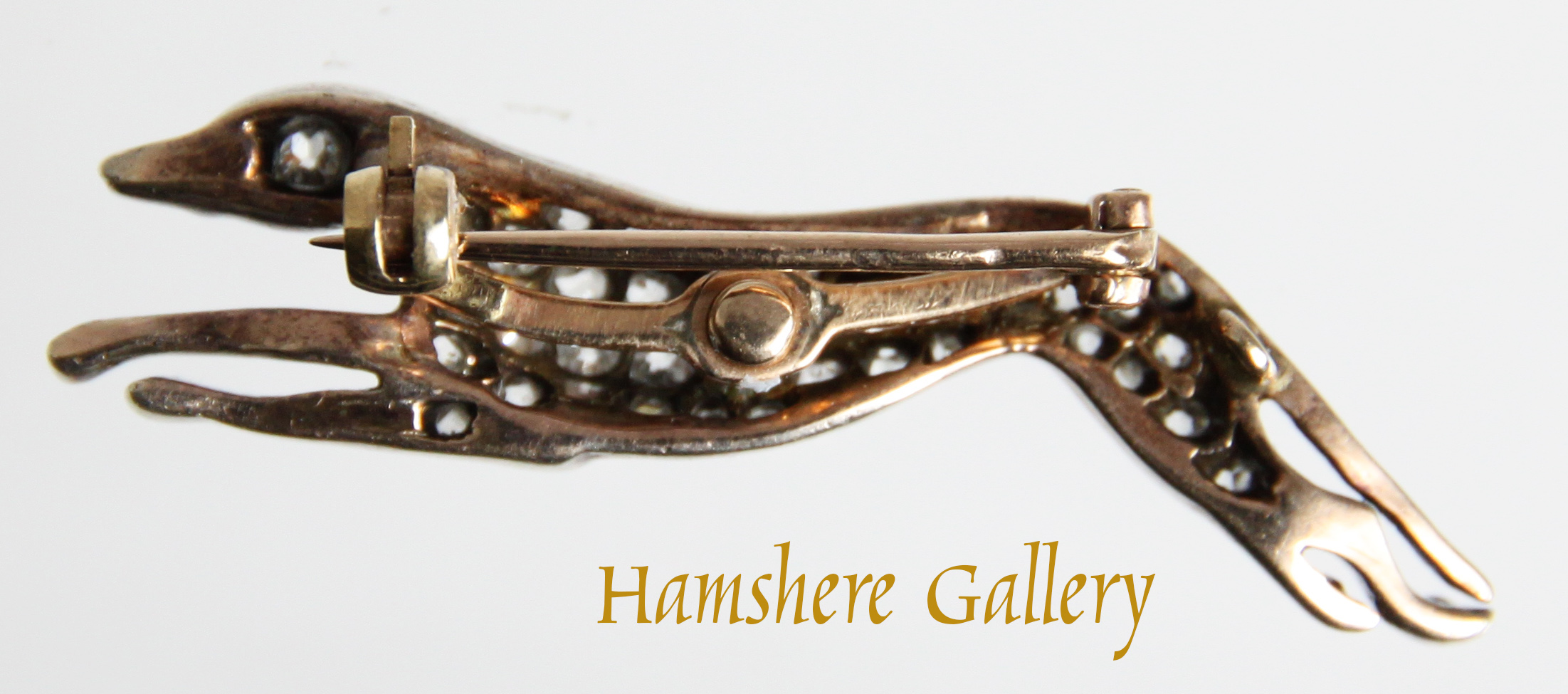 Click to see full size: A Victorian diamond coursing Greyhound brooch- A Victorian diamond coursing Greyhound brooch