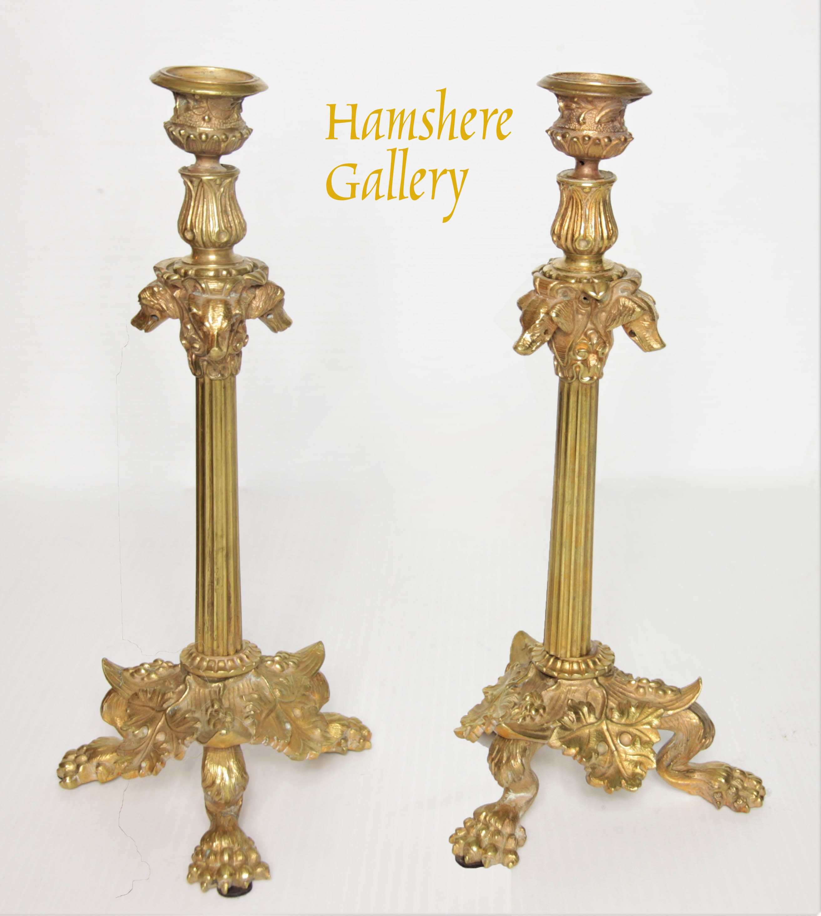 Click to see full size: A late 19th century, French, pair of ormolu bronze Setter candlesticks