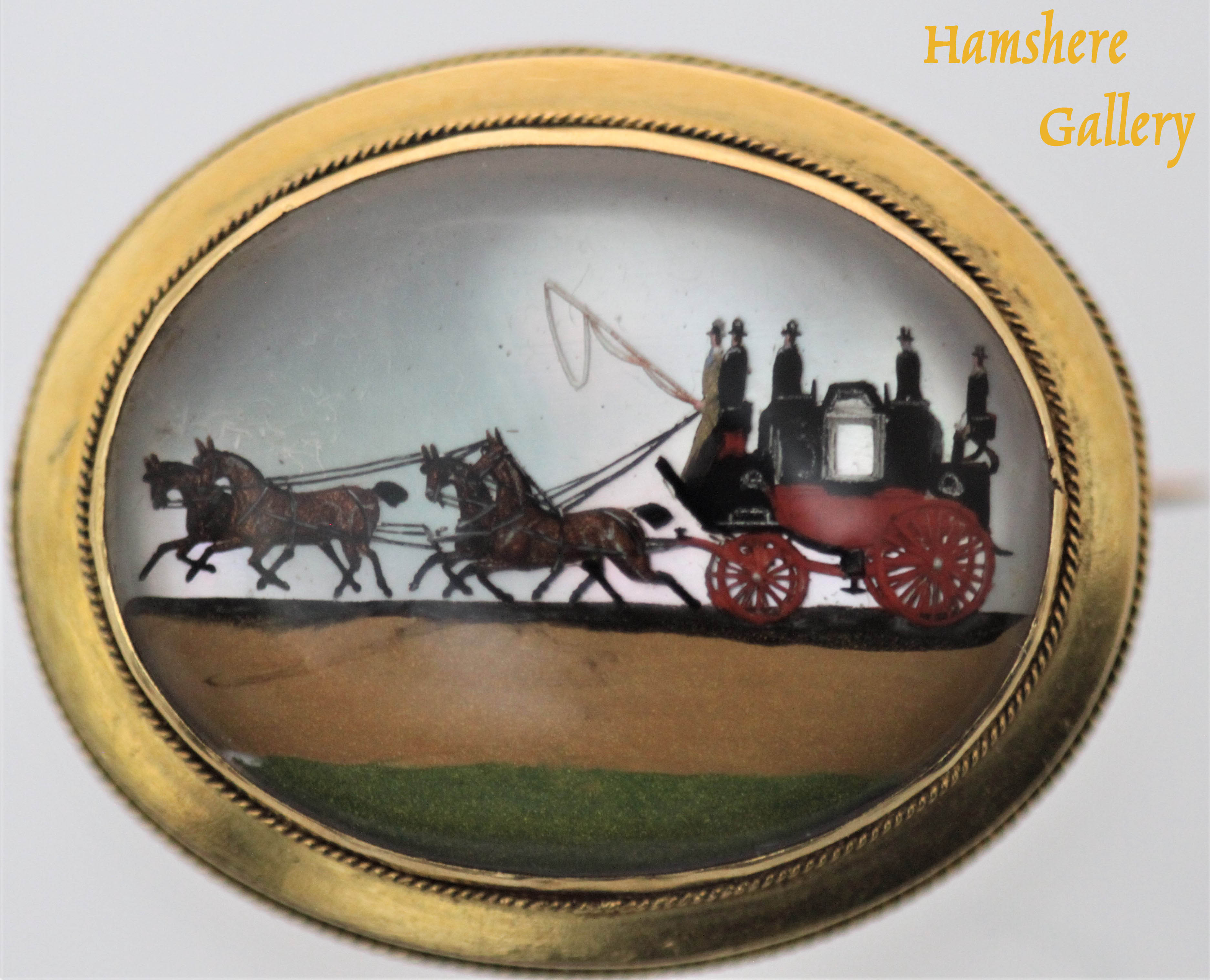 Click to see full size: English, circa 1905 reverse intaglio Royal Mail gold set coaching brooch