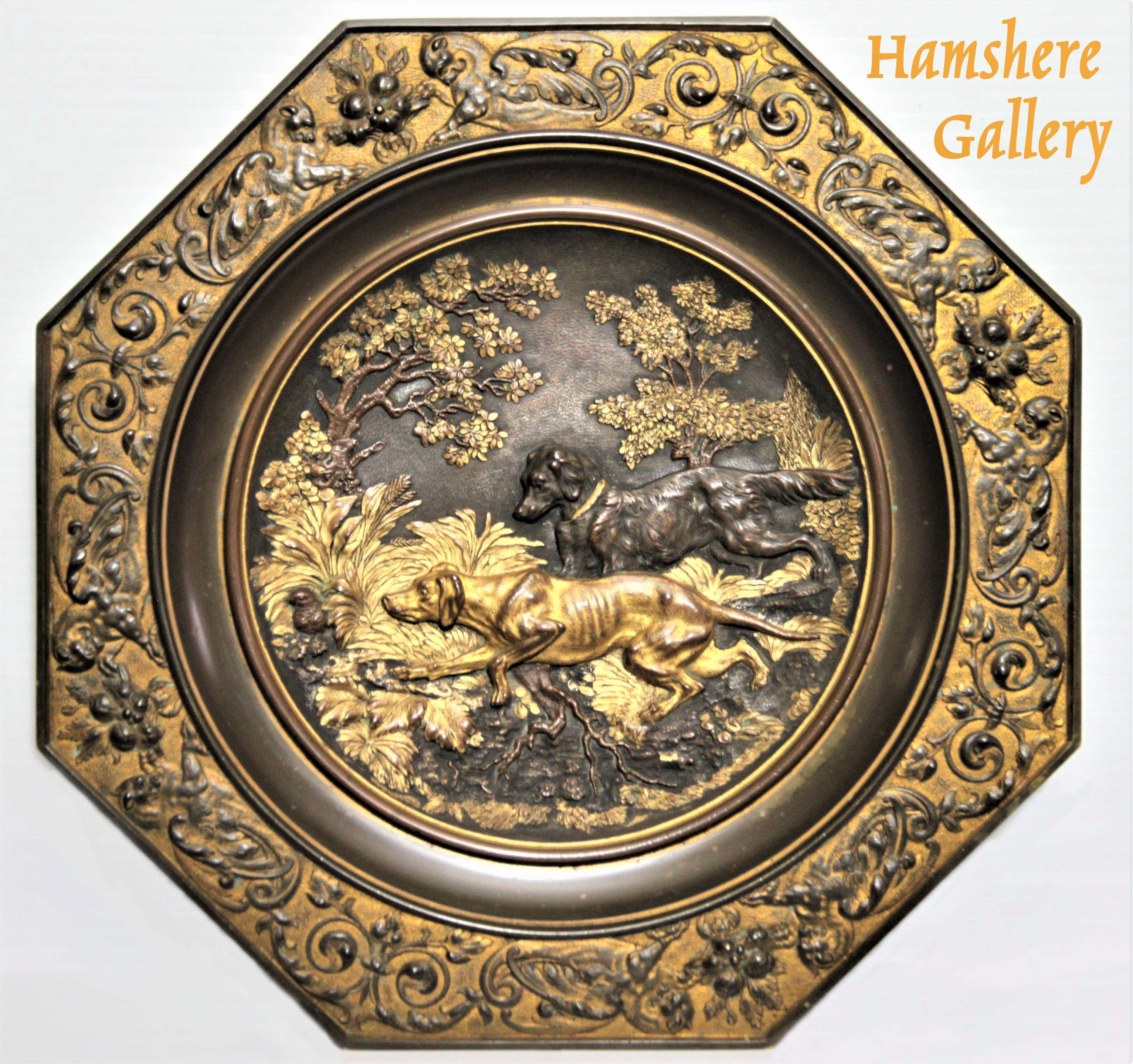 Click to see full size: A hexagonal hunting / 'La Chasse' bronze charger / plate of Pointer and Setter retailed by James Muirhead and Son- A hexagonal hunting / 'La Chasse' bronze charger / plate of Pointer and Setter retailed by James Muirhead and Son